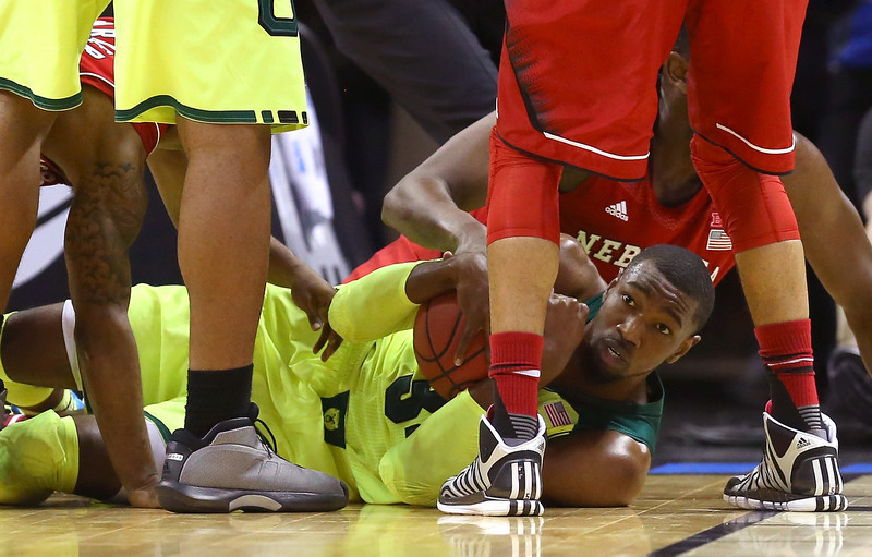 . Cory Jefferson #34 of the Baylor Bears fights for a loose ball with Leslee Smith #21 of the Nebraska Cornhuskers in the first half during the second round of the 2014 NCAA Men\'s Basketball Tournament at AT&T Center on March 21, 2014 in San Antonio, Texas.  (Photo by Ronald Martinez/Getty Images)