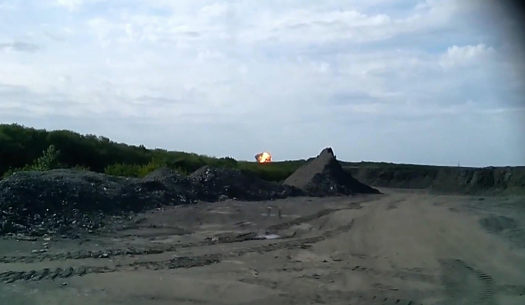 . In this image taken from amateur video, Thursday July 17, 2014, a fireball is seen in the distance shortly after a Malaysia Airlines passenger plane carrying 295 people was shot down Thursday as it flew over Ukraine, and plumes of black smoke rose up from the scene near the rebel-held village of Grabovo, in eastern Ukraine. Malaysia Airlines has tweeted that it lost contact with one of its flights as it was traveling from Amsterdam to Kuala Lumpur over Ukrainian airspace. (AP Photo / Amateur Video accessed by APTV)