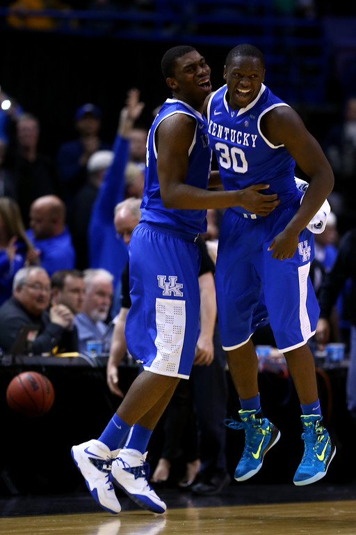 . Julius Randle #30 of the Kentucky Wildcats celebrates with teammate Dakari Johnson #44 after defeating the Wichita State Shockers 78 to 76 during the third round of the 2014 NCAA Men\'s Basketball Tournament at Scottrade Center on March 23, 2014 in St Louis, Missouri.  (Photo by Andy Lyons/Getty Images)