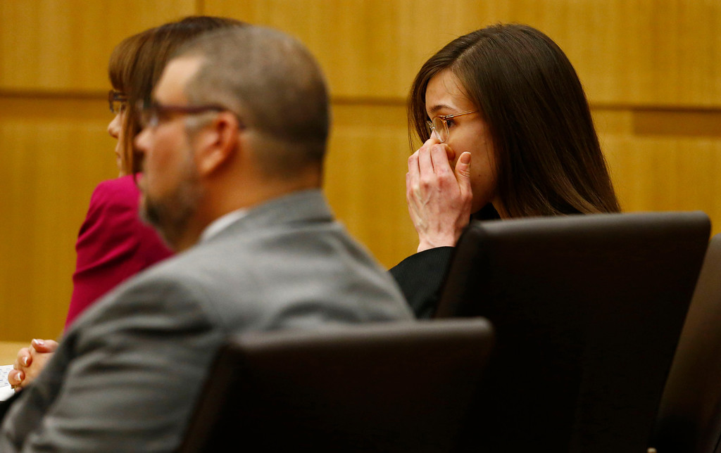 . Jodi Arias, right, reacts after she was found of guilty of first-degree murder in the gruesome killing her one-time boyfriend, Travis Alexander, in their suburban Phoenix home, Wednesday, May 8, 2013, at Maricopa County Superior Court in Phoenix.  (AP Photo/The Arizona Republic, Rob Schumacher, Pool)