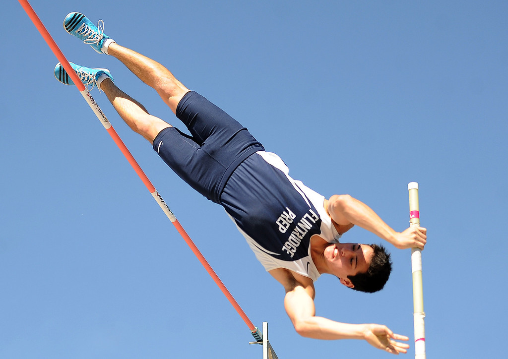 . Flintridge Prep\'s Barrett Weiss competes in the pole vault during the CIF-SS Masters Track and Field meet at Falcon Field on the campus of Cerritos College in Norwalk, Calif., on Friday, May 30, 2014.   (Keith Birmingham/Pasadena Star-News)