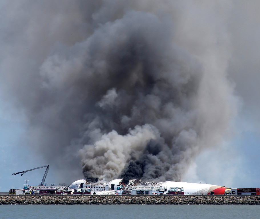 . Fire crews put out a fire on an Asiana Airlines Boeing 777 that crashed while landing at San Francisco International Airport on Saturday, July 6, 2013. (John Green/Bay Area News Group)