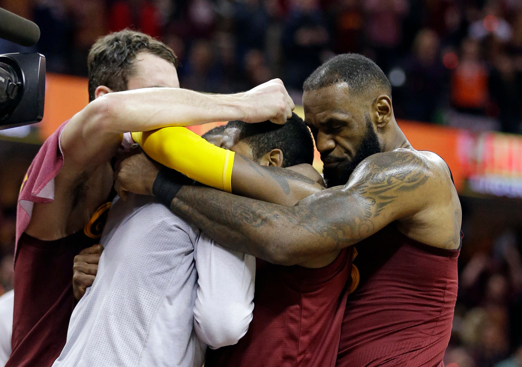 . The Cavaliers celebrate after defeating the Golden State Warriors 109-108 during an NBA basketball game, Sunday, Dec. 25, 2016, in Cleveland. (AP Photo/Tony Dejak)