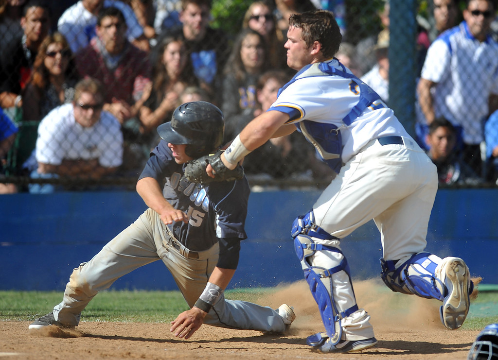 . La Mirada catcher Jeff Murray (#29) tags out Los Osos\' Kevin Riley (#15) at home plate in their CIF quarterfinal baseball game at La Mirada High School on Friday May 24, 2013. Los Osos beat La Mirada 8-5. (SGVN/Staff Photo by Keith Durflinger)