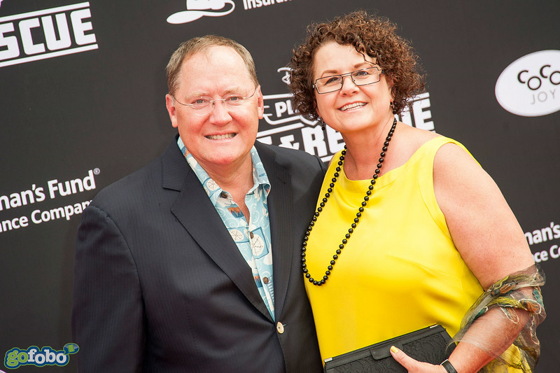 HOLLYWOOD, CA - JULY 15: Pixar chief creative officer John Lasseter (L) and Nancy Lasseter attend the premiere of Disney's 'Planes: Fire & Rescue' at the El Capitan Theatre on Tuesday July 15, 2014 in Hollywood, California. (Photo by Tom Sorensen/Moovieboy Pictures)
