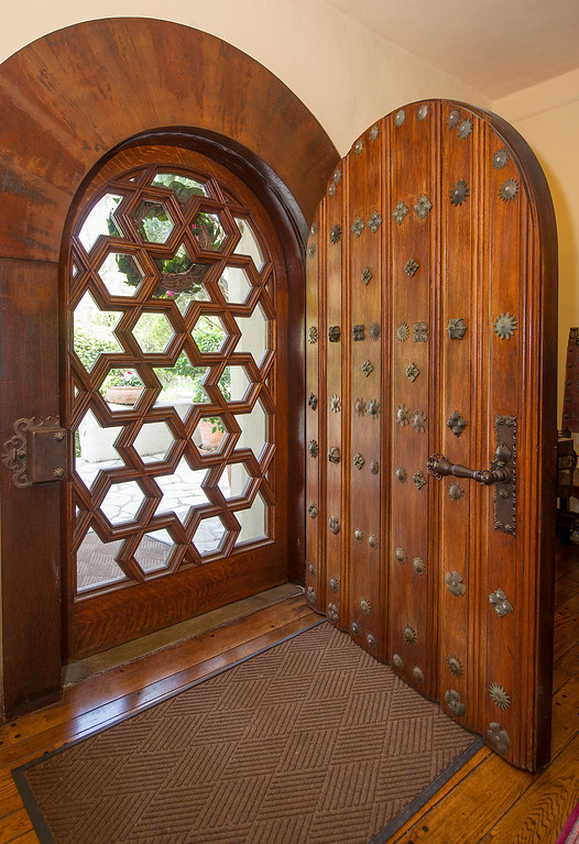 """. The front door of the La Casa Nueva, or \""""the new house.\"""" Built between 1922 and 1927, this 12,400-square-foot Spanish Colonial Revival mansion is noted for its fine architectural crafts, including stained glass, ceramic tile, wrought iron, and carved wood. La Casa Nueva, or \""""the new house.\"""" The Homestead Museum will honor seven of its volunteers, all local La Puente and Hacienda Heights residents, at its annual Volunteer Appreciation Dinner on Sat., April 6. The volunteers have given more than 4,700 hours of their time to the museum giving tours of the historic homes and properties as well as during the museum\'s festivals, workshops, youth programs and more. The volunteers to be honored are well trained docents with several years of experience. Carol Hamilton (1,000 hrs) and Eldon Dunn (6,000 hrs) of Hacienda Heights. (SGVN/Photo by Walt Mancini/Highlanders)"""