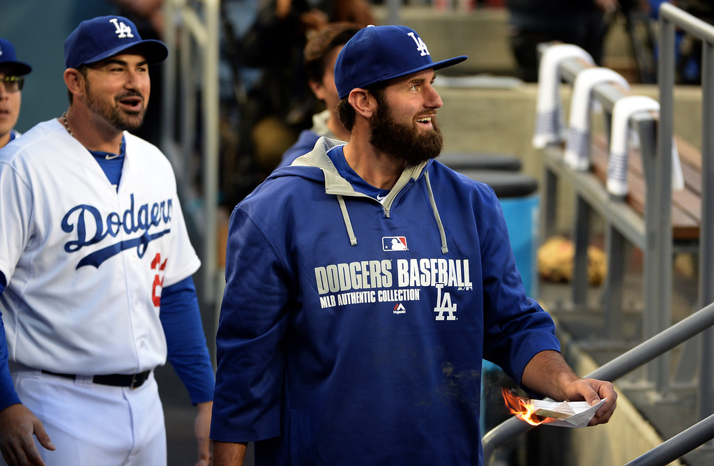 . Los Angeles Dodgers\' Scott Van Slyke, right, has fun in the dugout with Adrian Gonzalez (23) prior to a baseball game against the Philadelphia Phillies on Tuesday, April 22, 2013 in Los Angeles.   (Keith Birmingham/Pasadena Star-News)