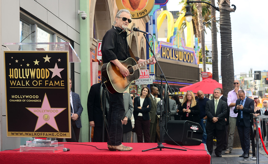 """. Kris Kristofferson performs \""""Me & Bobby McGee\"""" live on Hollywood Boulevard during posthumous Star ceremony for the late Janis Joplin on November 4, 2013 in Hollywood, California. Joplin, who had her siblings Michael and Laura at the ceremony, would have turned 70 years old this year and is the recipient of the 2,510th Star on the Hollywood Walk of Fame in the Category of Recording.         (FREDERIC J. BROWN/AFP/Getty Images)"""