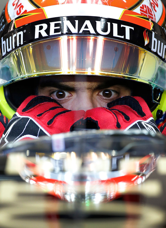 . Lotus driver Pastor Maldonado of Venezuela prepares for the first practice session for the Singapore Formula One Grand Prix on the Marina Bay City Circuit in Singapore, Friday, Sept. 19, 2014. Seen in the background is the financial skyline. (AP Photo/Ng Han Guan)