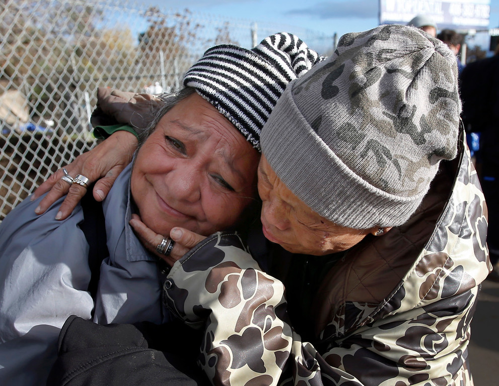 . Grace Hilliard, 59, left, a longtime resident of The Jungle, gets a hug from Mercy Wong, a volunteer from CHAM Deliverance Ministry, as the homeless camp is closed Thursday, Dec. 4, 2014, in San Jose, Calif. (Karl Mondon/Bay Area News Group)