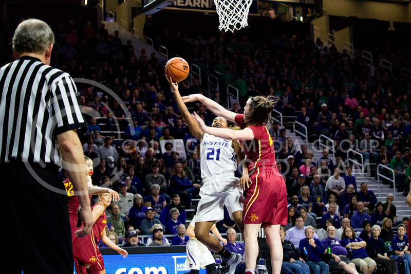Junior guard Karyla Middlebrook jumps to shoot the ball into the hoop despite her oppent's defense during the K-State game against Iowa State in Bramlage Coliseum on Feb. 11 2017 where the Wildcats beat the Cardinals 80-68. (Alanud Alanazi | The Collegian)