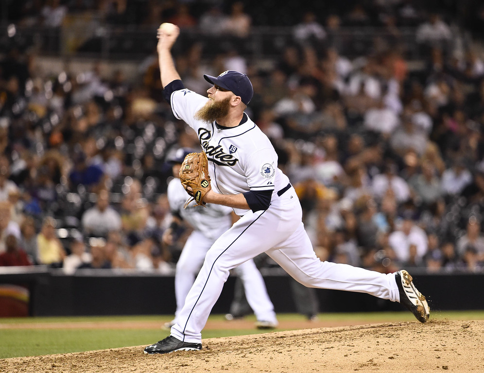 . SAN DIEGO, CA - SEPTEMBER 24:  Kevin Quackenbush #59 of the San Diego Padres pitches during the eighth inning of a baseball game against the Colorado Rockies at Petco Park September, 24, 2014 in San Diego, California.  (Photo by Denis Poroy/Getty Images)