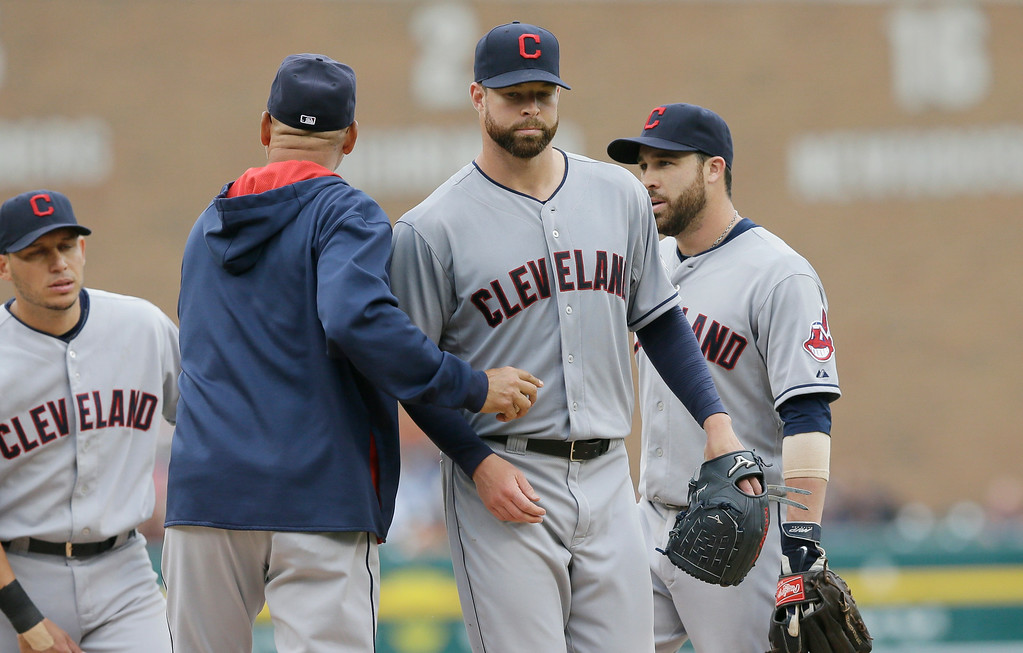 . Cleveland Indians starting pitcher Corey Kluber is relieved by manager Terry Francona during the ninth inning in the first baseball game of a doubleheader against the Detroit Tigers, Saturday, July 19, 2014 in Detroit. (AP Photo/Carlos Osorio)