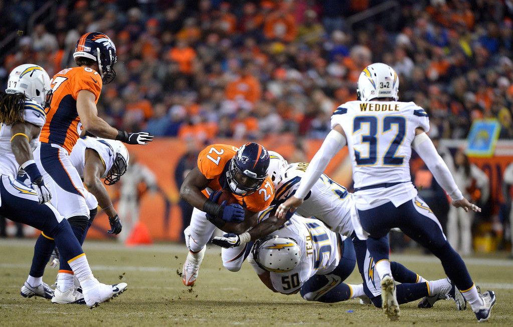 . Denver Broncos running back Knowshon Moreno (27) dives for extra yards during the first drive of the game. The Denver Broncos vs. the San Diego Chargers at Sports Authority Field at Mile High in Denver on December 12, 2013. (Photo by Joe Amon/The Denver Post)