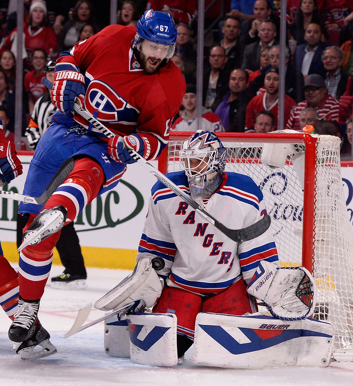 . Max Pacioretty #67 of the Montreal Canadiens screens Henrik Lundqvist #30 of the New York Rangers  during Game Five of the Eastern Conference Final in the 2014 NHL Stanley Cup Playoffs at Bell Centre on May 27, 2014 in Montreal, Canada.  (Photo by Richard Wolowicz/Getty Images)