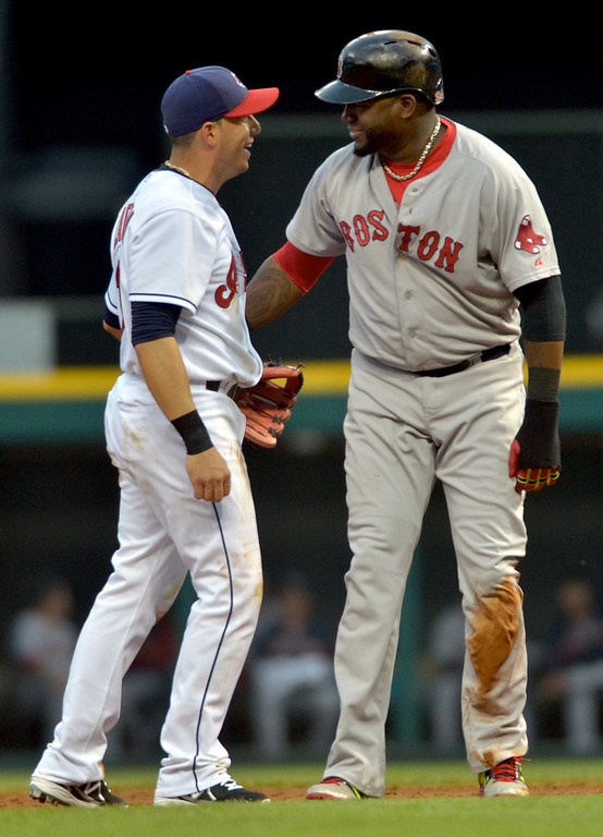 . Jeff Forman/JForman@News-Herald.com Indians short stop Asdrubal Cabrera and Boston runner David Ortiz joke with each other after Ortiz was caught at second base in a double play, for the second time in the game, in the sixth inning of the Indians\' 3-2 win over the Red Sox June 2 at Progressive Field.