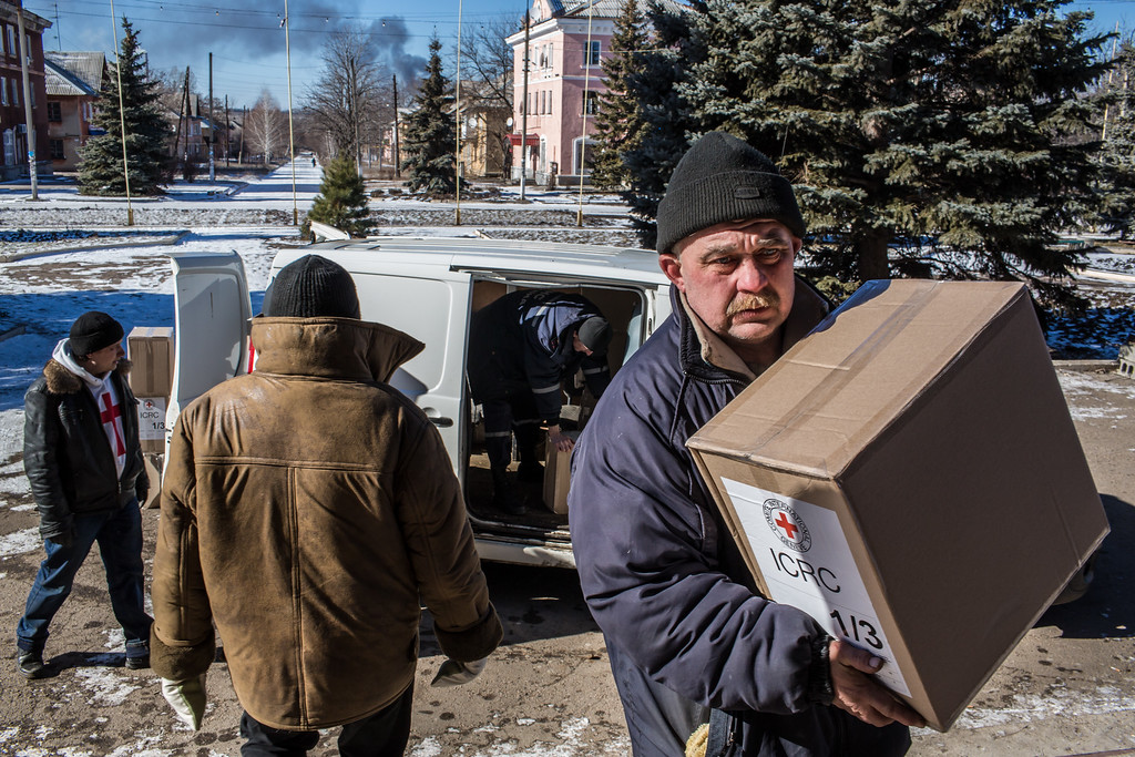 . MYRONIVSKYI, UKRAINE - FEBRUARY 17: Humanitarian aid is brought to the local House of Culture for distribution to local residents on February 17, 2015 in Myronivskyi, Ukraine. A ceasefire agreed to by Ukraine and pro-Russian rebel forces has failed to prevent fighting in the nearby town of Debaltseve, where thousands of Ukrainian troops remain and whom rebels claim to have surrounded. (Photo by Brendan Hoffman/Getty Images)