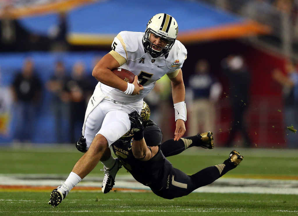 . GLENDALE, AZ - JANUARY 01: Quarterback Blake Bortles #5 of the UCF Knights is tackled by linebacker Eddie Lackey #5 of the Baylor Bears during the Tostitos Fiesta Bowl at University of Phoenix Stadium on January 1, 2014 in Glendale, Arizona.  (Photo by Ronald Martinez/Getty Images)