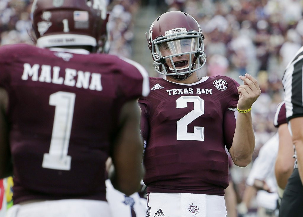 ". <p><b> Heisman Trophy winner Johnny Manziel, fresh off his half-game suspension, was penalized and then benched Saturday after he was caught � </b> <p> A. Taunting his opponents   <p> B. Removing his helmet during a touchdown celebration  <p> C. Signing 300 more autographs on the sideline <p><b><a href=\'http://www.twincities.com/sports/ci_23991196/johnny-manziel-taunts-touchdowns-mark-return-from-suspension\' target=""_blank\"">HUH?</a></b> <p>   (AP Photo/Eric Gay)"