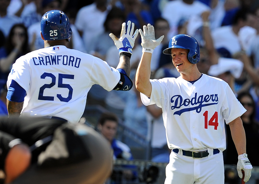 . The Dodgers\' Mark Ellis congratulates Carl Crawford after a homerun against the Cardinals during game 5 of the NLCS at Dodger Stadium Wednesday, October 16, 2013.(Hans Gutknecht/Los Angeles Daily News)