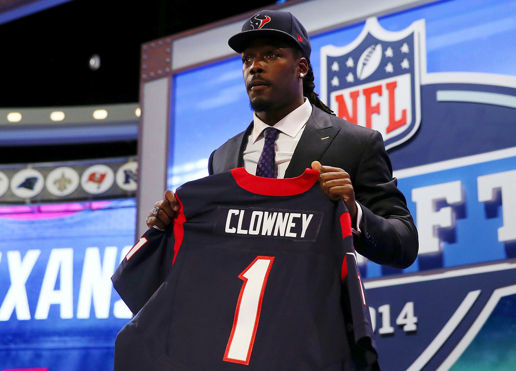 . Jadeveon Clowney of the South Carolina Gamecocks poses with a jersey after he was picked #1 overall by the Houston Texans during the first round of the 2014 NFL Draft at Radio City Music Hall on May 8, 2014 in New York City.  (Photo by Elsa/Getty Images)
