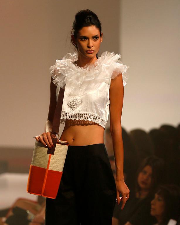. In this Wednesday, April 3, 2013 photo, a Sri Lankan model presents a creation by Kasuni Ratnasekera during the Colombo Fashion Week in Colombo, Sri Lanka. (AP Photo/Eranga Jayawardena)