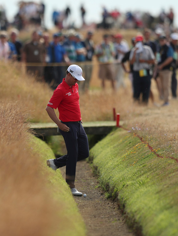 . Zach Johnson of the US looks at his ball during the third round of the British Open Golf Championship in Carnoustie, Scotland, Saturday July 21, 2018. (AP Photo/Jon Super)