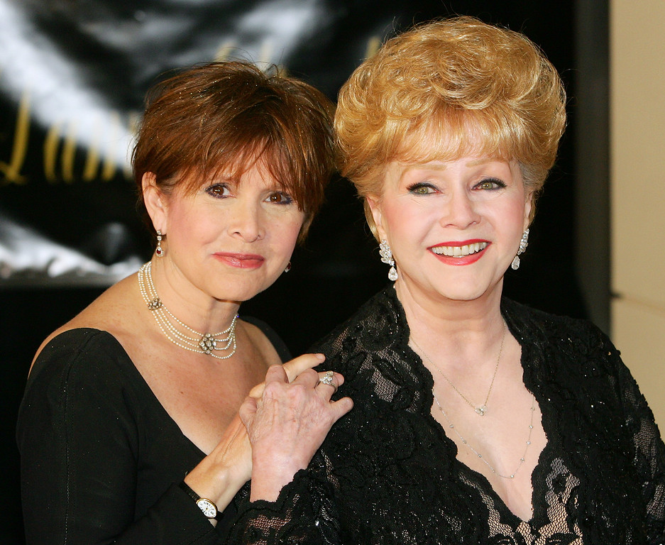 ". Actress Carrie Fisher (L) and her mother, actress Debbie Reynolds, arrive for Dame Elizabeth Taylor\'s 75th birthday party at the Ritz-Carlton, Lake Las Vegas on February 27, 2007 in Henderson, Nevada. Reynolds, star of the 1952 classic ""Singin\' in the Rain\"" died Wednesday, Dec. 28, 2016. She was 84. Her daughter, Fisher, died Dec. 27, 2016. (Photo by Ethan Miller/Getty Images)"