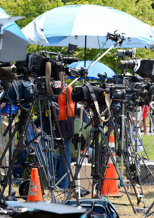. Members of the news media are set up on the street across from the home of New England Patriots tight end Aaron Hernandez in North Attleboro, Massachusetts, USA, 21 June 2013. The body of 27-year-old Odin Lloyd, a semi-pro football player and acquaintance of Hernandez, was found on 17 June 2013 in a industrial area about 1 mile (1.6 km) from the home of Hernandez. According to media reports, police have issued an arrest warrant for Hernandez on alleged obstruction of justice charges.  EPA/CJ GUNTHER