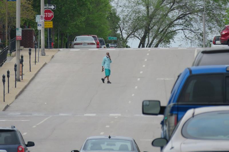 Jaywalkers on Locust near 12th Street in Kansas City in May 2021.