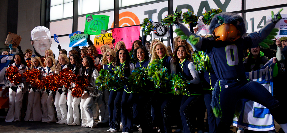 . Denver Bronco and Seattle Seahawks cheerleaders lead the cheers to start the Today Show on January 31, 2014, New York, NY. (Photo By Joe Amon/The Denver Post)