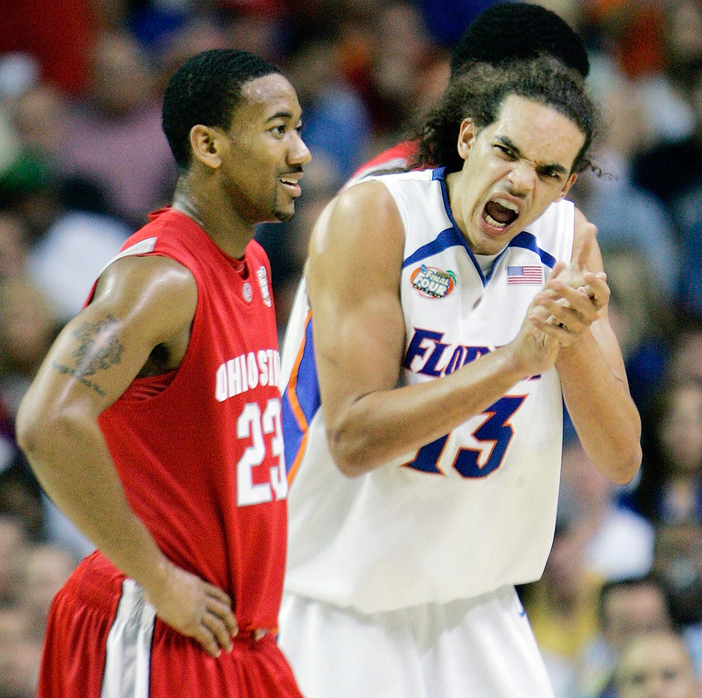 . Florida\'s Joakim Noah (13) reacts in the first half against Ohio State\'s David Lighty (23) during their men\'s championship basketball game at the Final Four in the Georgia Dome in Atlanta Monday, April 2, 2007. (AP Photo/Gerry Broome)