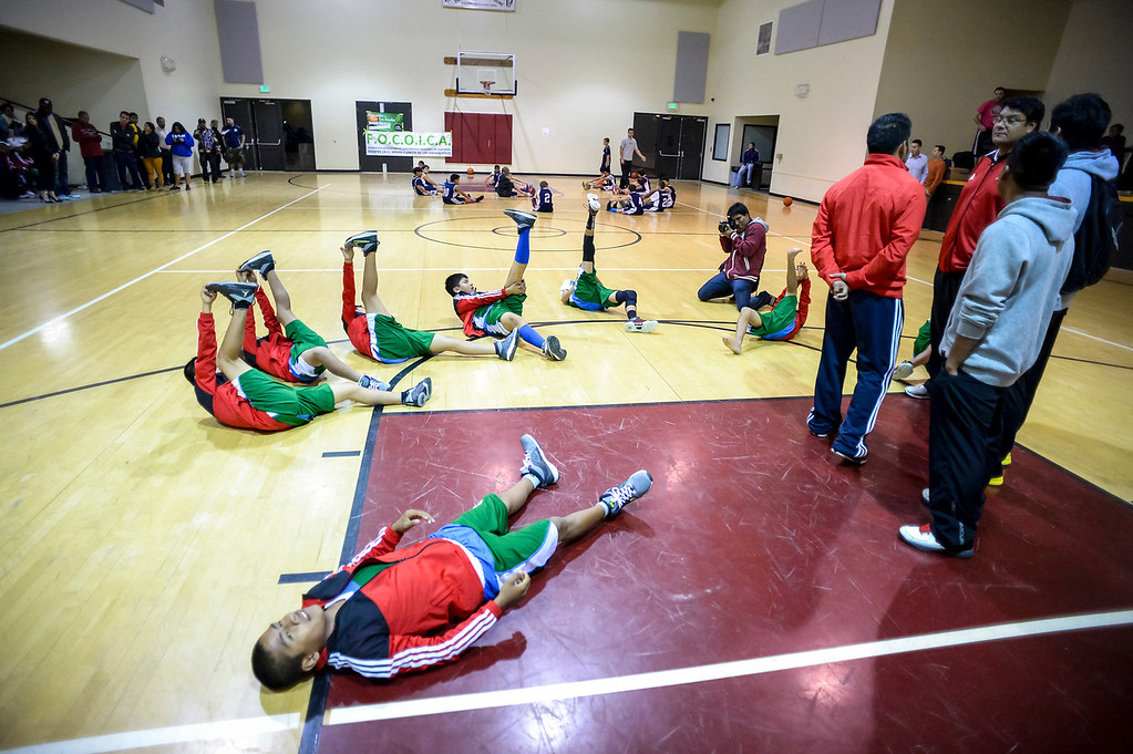 """. Triqui kids basketball team, from the mountainous region of Oaxaca, Mexico, who have been called the \""""Barefoot Champions of the Mountain,\"""" are known throughout their native Mexico for playing basketball without shoes took on the local Top Flight boys team at the Pacific Boys Lodge in Woodland Hills, CA Wednesday, December 18, 2013.  The Triqui team warms up.  (Photo by David Crane/Los Angeles Daily News)"""