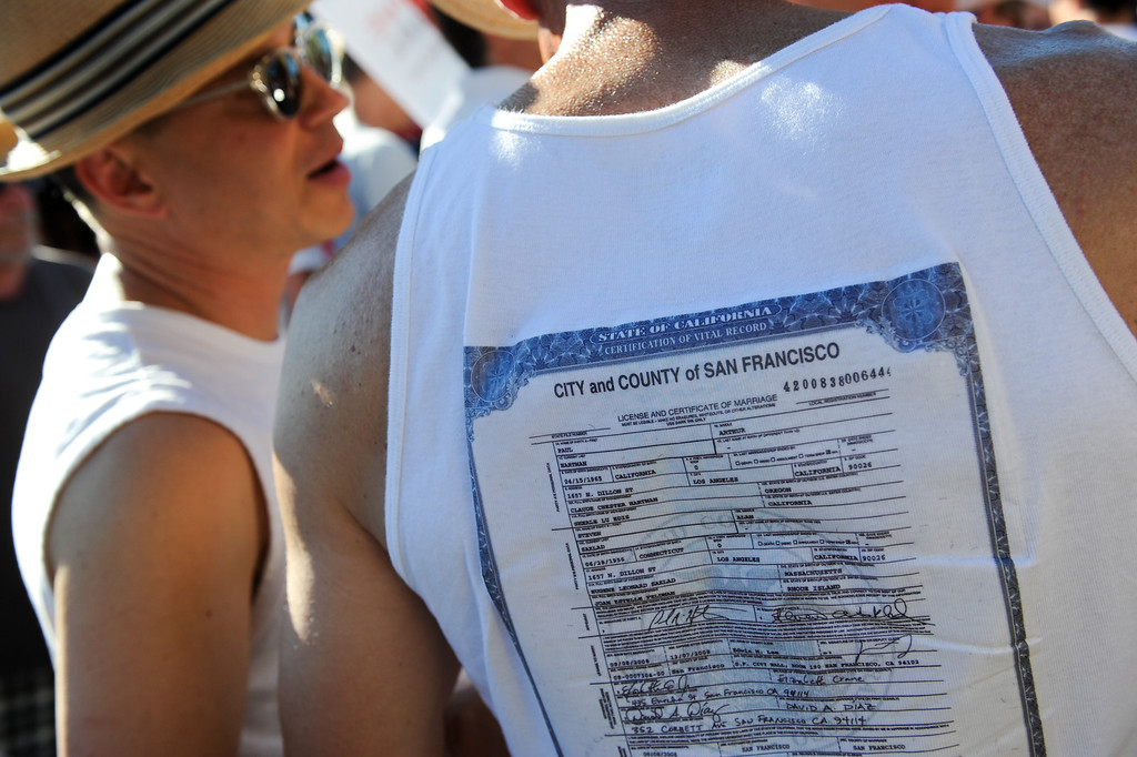 . Paual Hartman wears a shirt with a photo of his 2008 marriage license when he married Steve Saklad, left, at the rally in West Hollywood to celebrate the U.S. Supreme Court\'s ruling that killed Prop 8, Wednesday, June 26, 2013. (Michael Owen Baker/L.A. Daily News)