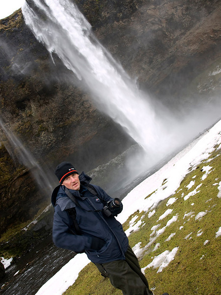 Seljalandsfoss is one of the most famous waterfalls of Iceland. It is very picturesque and situated between Selfoss and Skógafoss.This waterfall of the river Seljalandsá drops 60 metres (200 ft) over the cliffs of the former coastline.   It is possible to walk behind the waterfall albeit via a dodgy  icy, narrow track. Well worth it though as the view close up is breathtaking. Me looking dazed! Captured with Olympus E510, 14-42mm.
