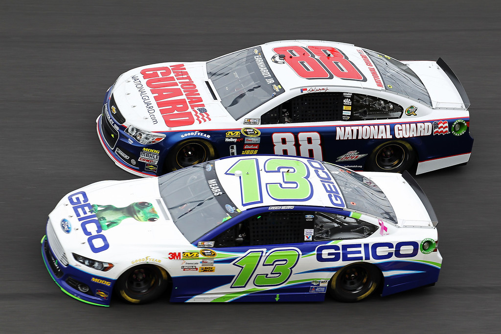 . Casey Mears, driver of the #13 GEICO Toyota, and Dale Earnhardt Jr., driver of the #88 National Guard Chevrolet, race  during the NASCAR Sprint Cup Series Daytona 500 at Daytona International Speedway on February 24, 2013 in Daytona Beach, Florida.  (Photo by Todd Warshaw/Getty Images)