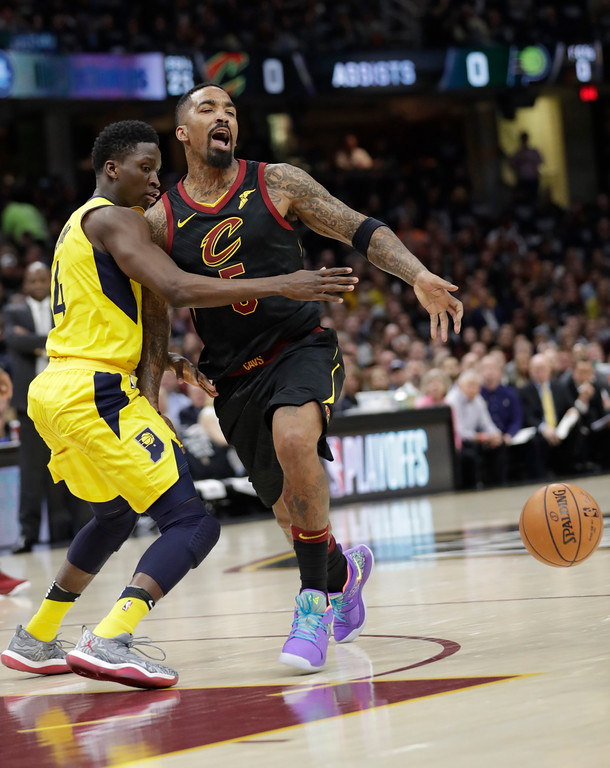 . Indiana Pacers\' Victor Oladipo (4) knocks the ball loose from Cleveland Cavaliers\' JR Smith (5) in the first half of Game 7 of an NBA basketball first-round playoff series, Sunday, April 29, 2018, in Cleveland. (AP Photo/Tony Dejak)
