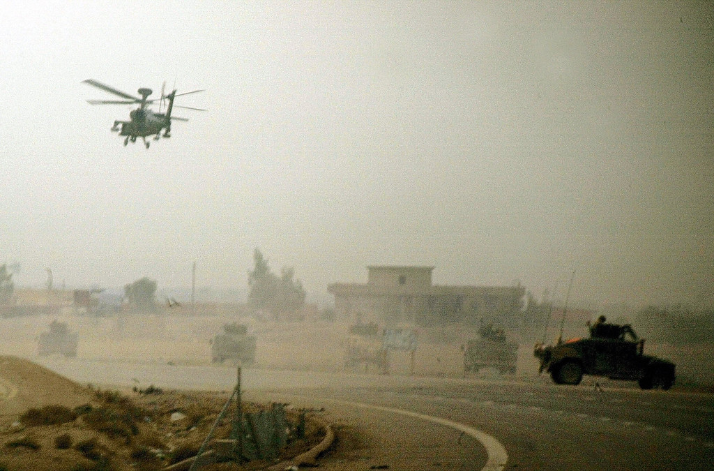 . An Apache helicopter and Humvees with 1/5 Cavalry comb the northern outskirts of restive Sunni Muslim city of Fallujah, 50 kms west of Baghdad, 08 November 2004.    AFP PHOTO/PATRICK BAZ/AFP/Getty Images)