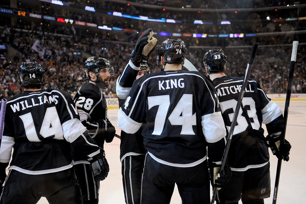 . The Kings\' Dwight King is congratulated after his first period goal against the Blackhawks during game six of the Western Conference Finals, Friday, May 30, 2014, at Staples Center. (Photo by Michael Owen Baker/Los Angeles Daily News)