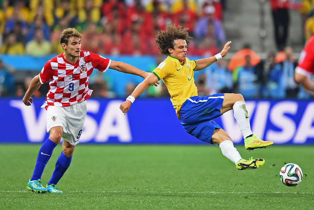 . David Luiz of Brazil tries to control the ball against Nikica Jelavic of Croatia in the first half during the 2014 FIFA World Cup Brazil Group A match between Brazil and Croatia at Arena de Sao Paulo on June 12, 2014 in Sao Paulo, Brazil.  (Photo by Buda Mendes/Getty Images)