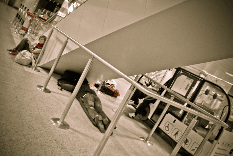 sleeping in the airport under escalator.jpg
