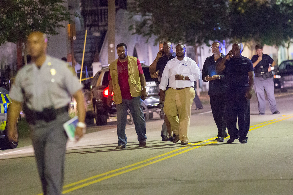 . A group of local clergy return from the historic Mother Emanuel African Methodist Episcopal Church where a gunman opened fire on a prayer meeting killing nine people on June 17, 2015 in Charleston, South Carolina.  Police believe the attack is a hate crime and are searching for a young white man believed to be the only shooter.  (Photo by  Richard Ellis/Getty Images)