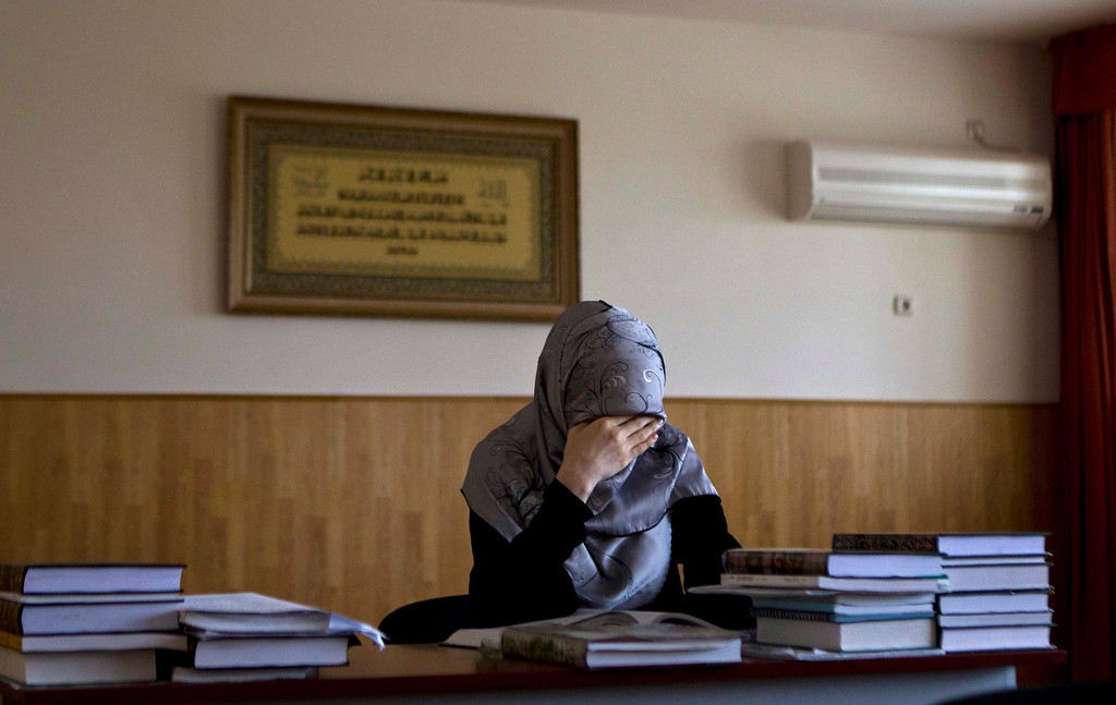 . A student attends a lesson in Sharia law at the Russian Islamic University in the Chechen capital Grozny April 23, 2013. The naming of two Chechens, Dzhokhar and Tamerlan Tsarnaev, as suspects in the Boston Marathon bombings has put Chechnya - the former site of a bloody separatist insurgency - back on the world\'s front pages. Chechnya appears almost miraculously reborn. The streets have been rebuilt. Walls riddled with bullet holes are long gone. New high rise buildings soar into the sky. Spotless playgrounds are packed with children. A giant marble mosque glimmers in the night. Yet, scratch the surface and the miracle is less impressive than it seems. Behind closed doors, people speak of a warped and oppressive place, run by a Kremlin-imposed leader through fear.   Picture taken April 23, 2013.   REUTERS/Maxim Shemetov