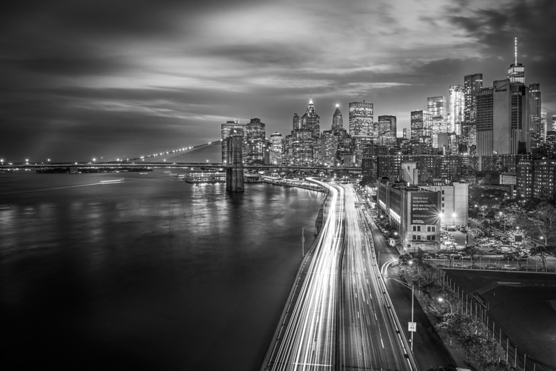 Downtown-From-Manhattan-Bridge-And-FDRDrive-LightTrails-BW.png