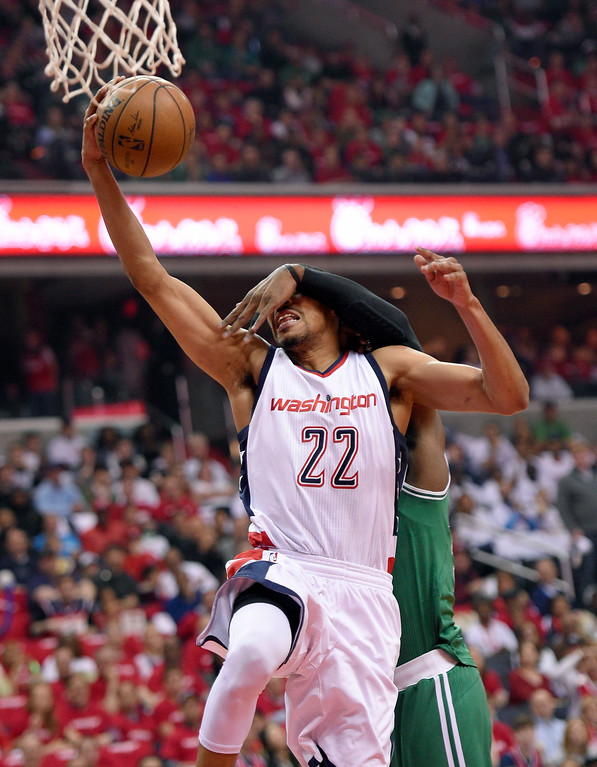 . Washington Wizards forward Otto Porter Jr. (22) gets fouled by Boston Celtics forward Jae Crowder, back, during the first half in Game 4 of a second-round NBA basketball playoff series, Sunday, May 7, 2017, in Washington. (AP Photo/Nick Wass)