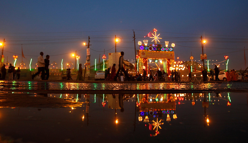 ". An ""akhara\"" or sect of holy Hindu men is lit up with decorative lighting during the Maha Kumbh festival in Allahabad, India, Monday, Jan. 28, 2013. Millions of Hindu pilgrims are expected to attend the Maha Kumbh festival, which is one of the world\'s largest religious gatherings that lasts 55 days and falls every 12 years. (AP Photo/Rajesh Kumar Singh)"