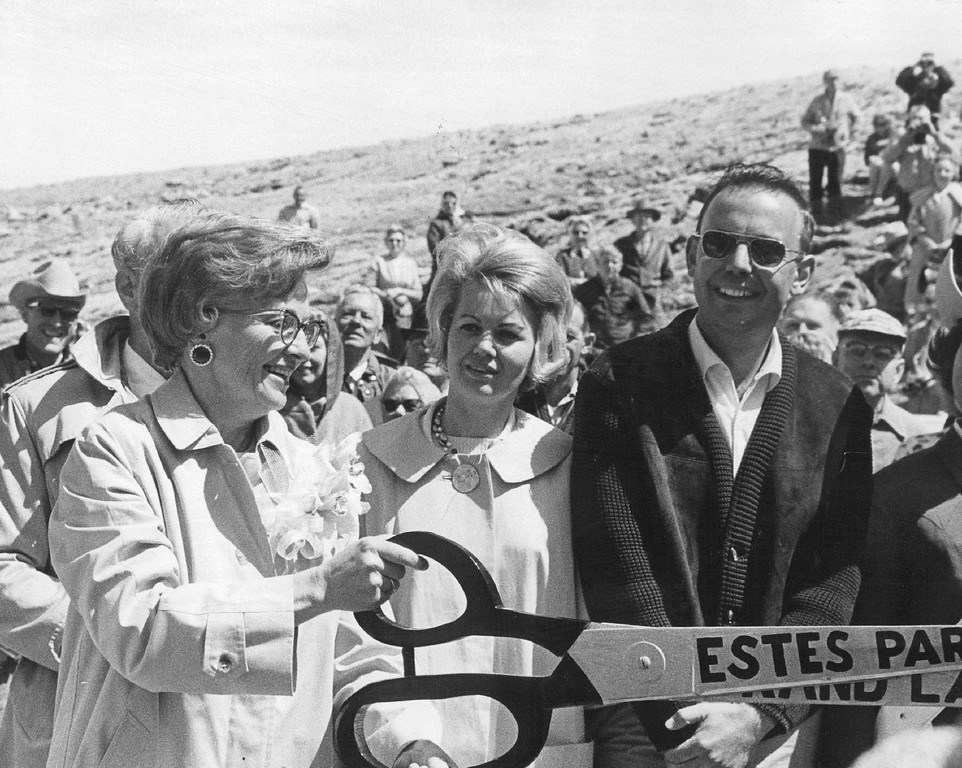 . Mrs. John Love, wife of the Colorado governor, snips the ribbon to officially open Trail Ridge Road in 1966, the highest continuous highway in the nation. The road through Rocky Mountain National Park passes panoramas of spectacular mountain scenery. (Monk Tyson/The Denver Post)