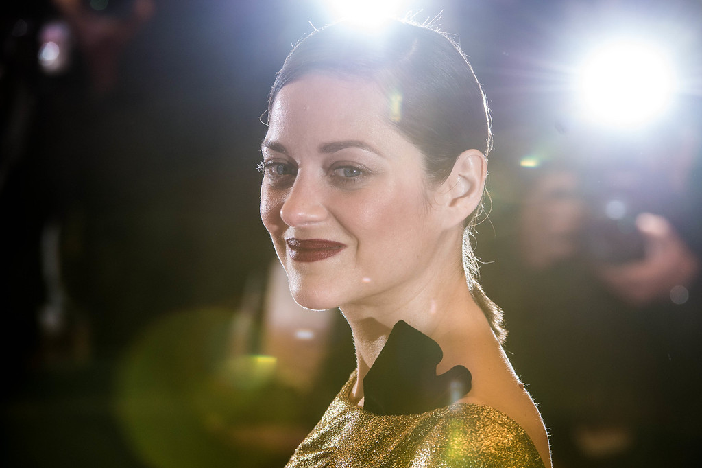 ". CANNES, FRANCE - MAY 15:  Actress Marion Cotillard leaves the ""From The Land Of The Moon (Mal De Pierres)\"" premiere during the 69th annual Cannes Film Festival at the Palais des Festivals on May 15, 2016 in Cannes, France.  (Photo by Ian Gavan/Getty Images)"