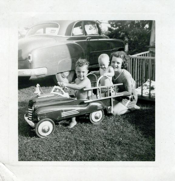 1951 Butch, Ken, Bonnie and fire engine.jpeg