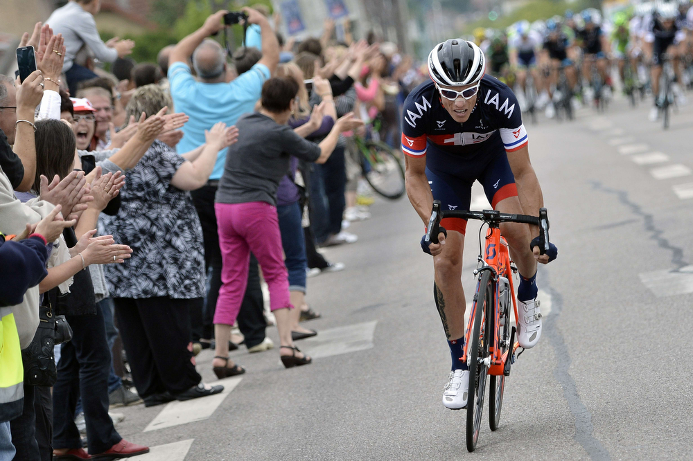 . France\'s Sylvain Chavanel rides in a breakaway as supporters cheer along the road during the 161 km eighth stage of the 101st edition of the Tour de France cycling race on July 12, 2014 between Tomblaine and Gerardmer La Mauselaine, eastern France. (JEFF PACHOUD/AFP/Getty Images)